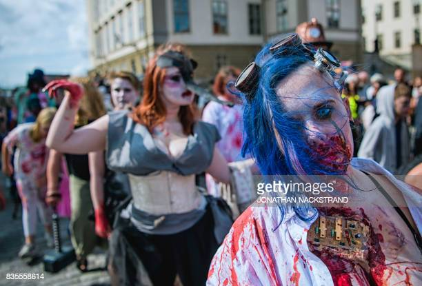 People dressed up as zombies participate in a zombie walk in Stockholm on August 19 2017 / AFP PHOTO / Jonathan NACKSTRAND