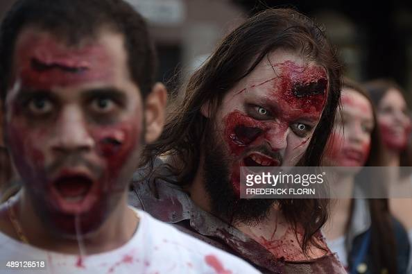 People dressed up as zombies take part in a Zombie Walk event on September 19 2015 in the eastern French city of Strasbourg on the sideline of the...