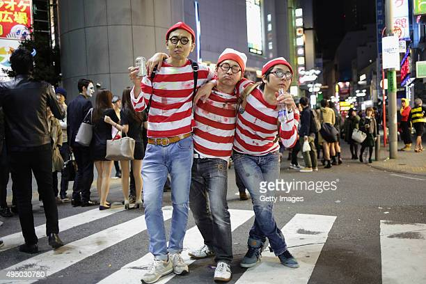 People dressed up for Halloween pose for portraits in Shibuya district on October 30 2015 in Tokyo Japan