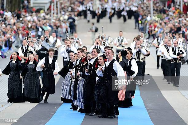 People dressed with folk costumes dance during the 42nd Lorient Interceltic Festival parade on August 5 2012 in Lorient French Brittany For more than...