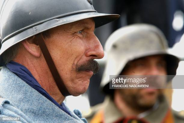 People dressed with WWI uniforms take part in a ceremony marking the 100th anniversary of the Chemin des Dames battle on April 16 2017 in...