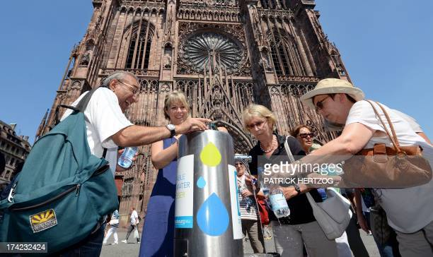 People drink at a water dispenser in front of the cathedral of Strasbourg eastern France on July 22 as France swelters under a summer heatwave AFP...