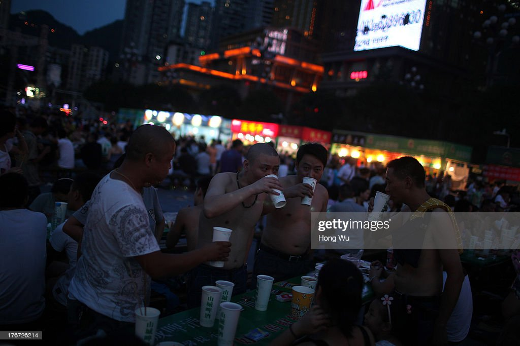 People drink beer and enjoy the coolness in the night on August 4, 2013 in Chongqing, China. Chongqing is a major city in southwest China and became the municipality was created on 14 March 1997. It known as a 'Mountain City' and 'River City' was constructed on the mountain and along the Yangtze River.
