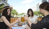 People drink beer in Odori Park in the northern Japan city of Sapporo on July 20 as one of the biggest summer beer gardens in Japan opens The...