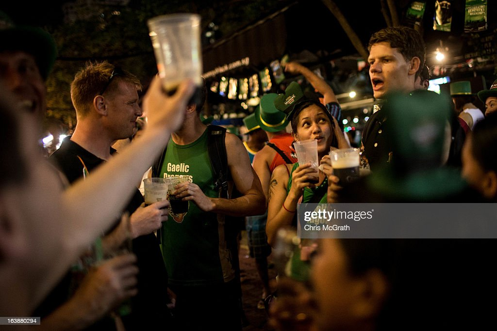People drink beer to celebrate St Patricks Day during the Singapore St Patrick's Day street Festival at Boat Quay on March 17, 2013 in Singapore. Singapore's Irish community gathered at Boat Quay for a three-day-long St Patrick's Day Street Festival which featured street performances, buskers, and Irish food and drink.