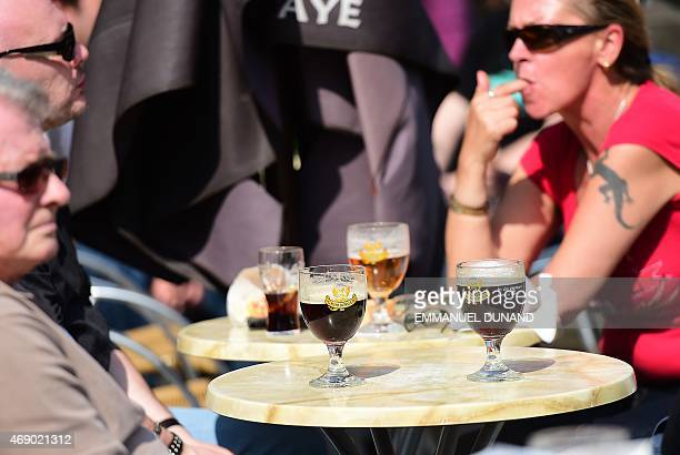 People drink beers at a terrace in Brussels on April 9 2015 In the fight against drinking and alcoholism European lawmakers have taken the first step...