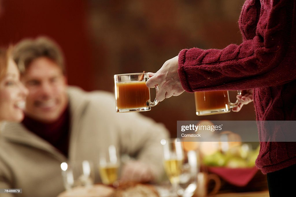 People drinking apple cider