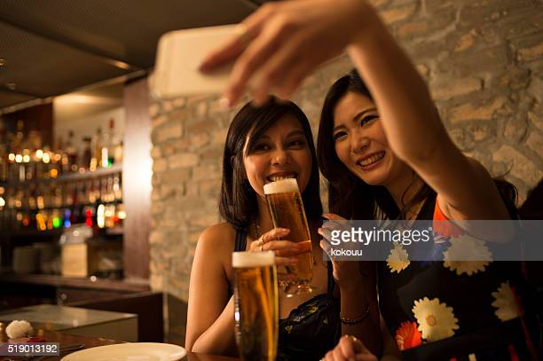People drinking beer and taking pictures