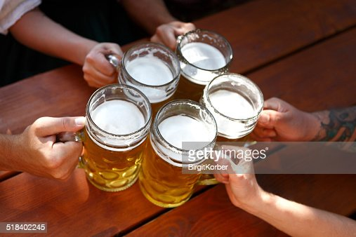 People drinking beer in a traditional Bavarian beer garden : Stock Photo