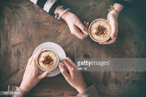 People drinking coffee high angle view : Stock Photo
