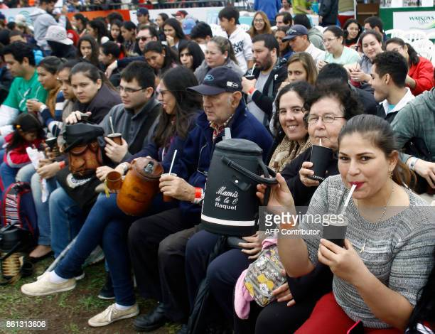 People drinking 'terete' gather in Asuncion to break the Guinness World Record for the largest 'terere' round of the world on October 14 2017 1332...