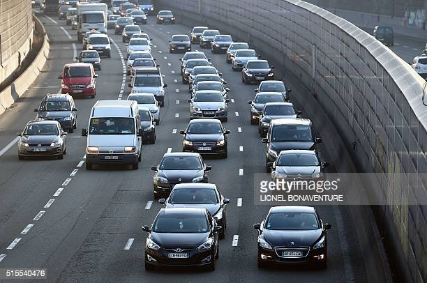 People drive cars on the Paris ring during a ' slow down' demonstration between Roissy Charles de Gaulle airport and Paris of nonlicensed private...