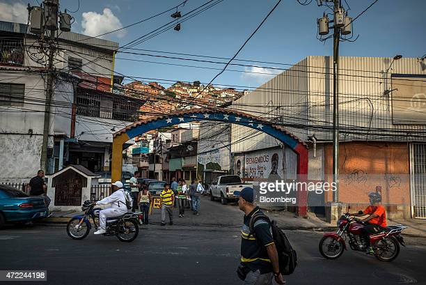People drive motorcycles along the street in the Petare neighborhood home to many Colombian immigrants on the outskirts of Caracas Venezuela on...