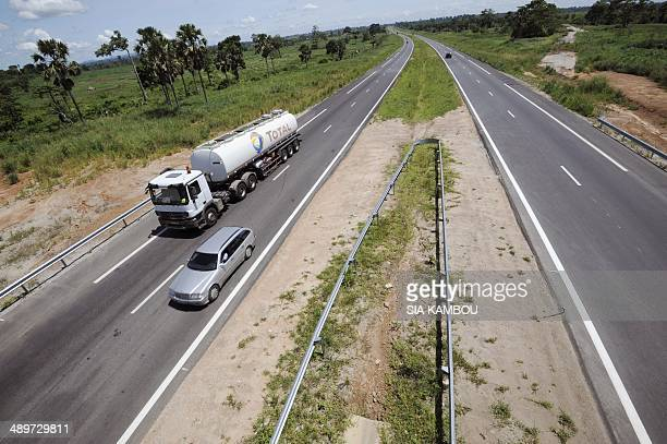 People drive their vehicules on the new 230 km long AbidjanYamoussoukro highway on May 11 2014 This northern highway inaugurated on December 11 2013...