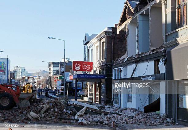 People driving front loaders work on moving rubble blocking Victoria Street in Christchurch on September 4 2010 after a powerful 70 earthquake A...