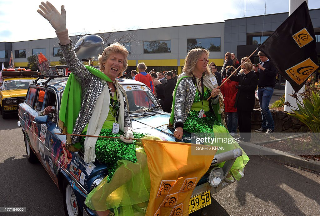 People driving vintage classic cars leave for a 4,425-kilometer journey to raise funds to support of children in need, at the 29th annual Variety Bash in western Sydney on August 22, 2013. The fleet that consist of vintage cars spanning three decades from 1959 to 1974 will finish its journey on August 30, 2013 in Ballarat in Victoria state. AFP PHOTO / Saeed KHAN