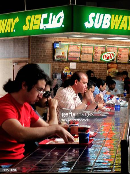 NAGGAR People eat at a fast food outlet in Dubai on April 27 2009 If it's not the fatty foods it's the lack of exercise or probably both More and...