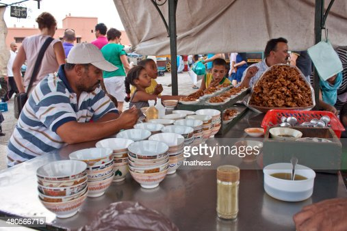 people eat at a stall : Stock Photo