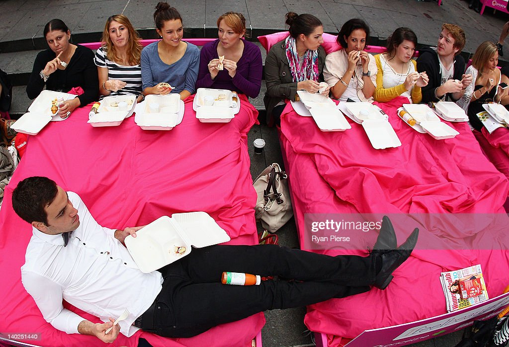 People eat breakfast in bed during the The World's Biggest Breakfast in Bed Guinness World Record Attempt at Martin Place on March 2, 2012 in Sydney, Australia.