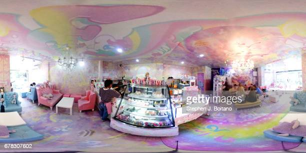 People eat drink and take photos at the Unicorn Cafe a unicorn and rainbow themed cafe in Bangkok Thailand