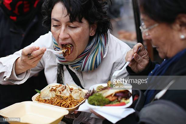 People eat food in Camden Market on March 31 2012 in London England Camden in North London has been one of the city's cultural centres since the...