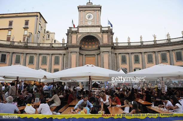 People eat free pizza margheritas in Dante square in downtown Naples on August 27 2008 Pizza chefs in Naples gave away more than 5000 free pizzas to...