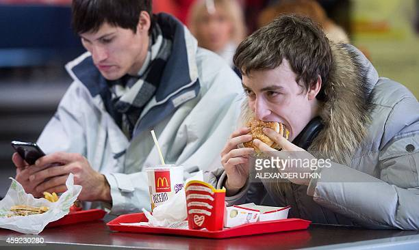 People eat in a McDonald's restaurant after it reopened following a hygiene probe in Moscow on November 19 2014 McDonald's reopened its flagship...