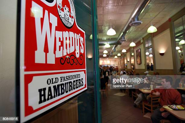 People eat in a Wendy's April 24 2008 in New York City Wendy's International Inc which is the nation's No 3 hamburger chain was bought by Triarc...