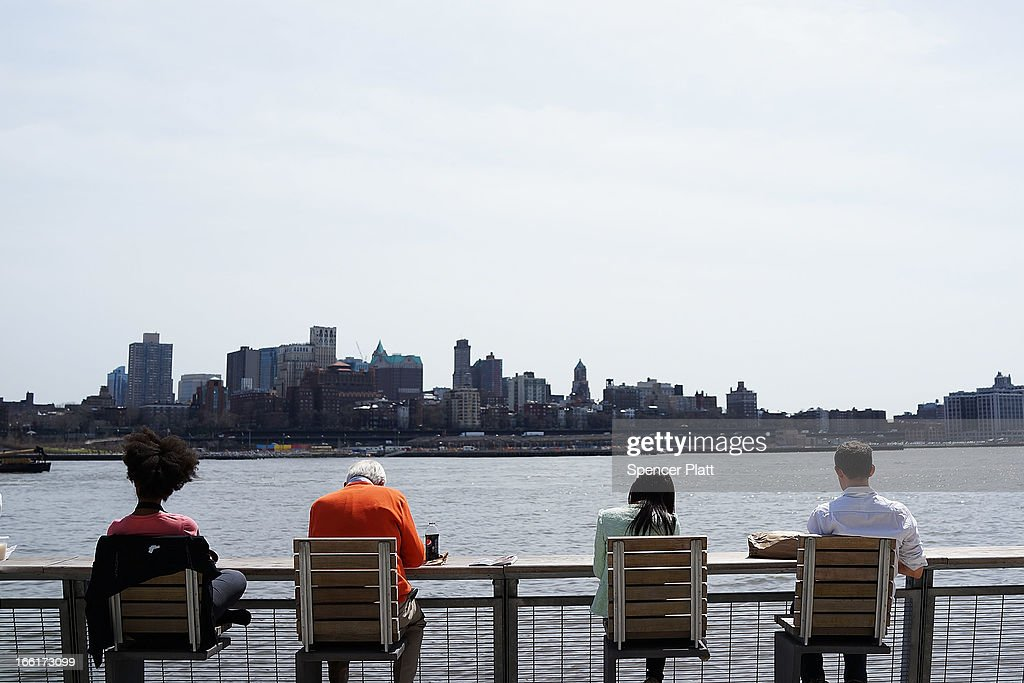 People eat lunch along the East River in lower Manhattan during warm weather on April 9, 2013 in New York City. For the first time since October, temperatures are expected to rise above 70 degrees this week in New York and surrounding areas.