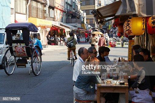People eating at street restaurant, Asakusa