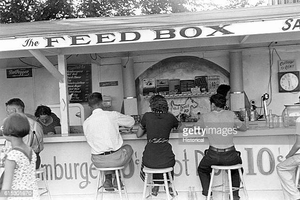 People eating at the Feed Box a food stand at Buckeye Lake Amusement Park Near Columbus Ohio Summer 1938