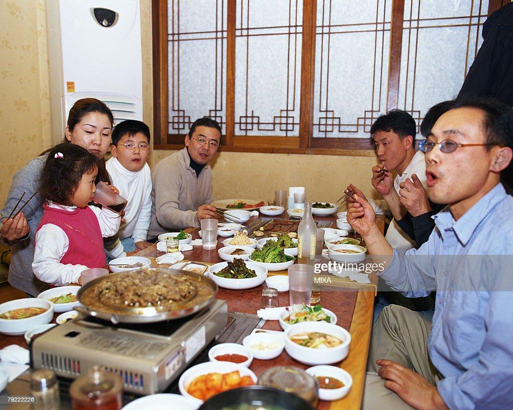 People eating in a Korean restaurant