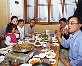 People eating in a Korean restaurant