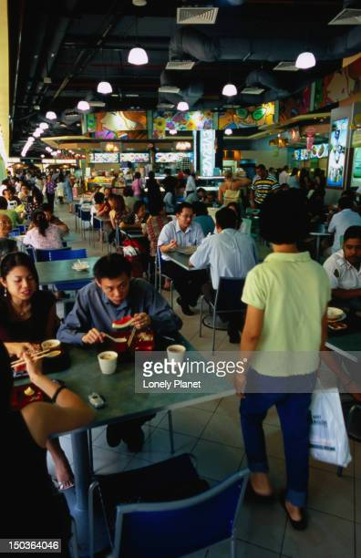 People eating in Tekka Centre Market, Little India.