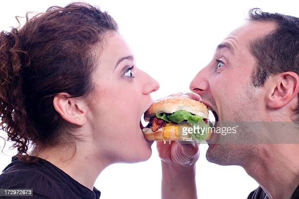 People eating juicy burger