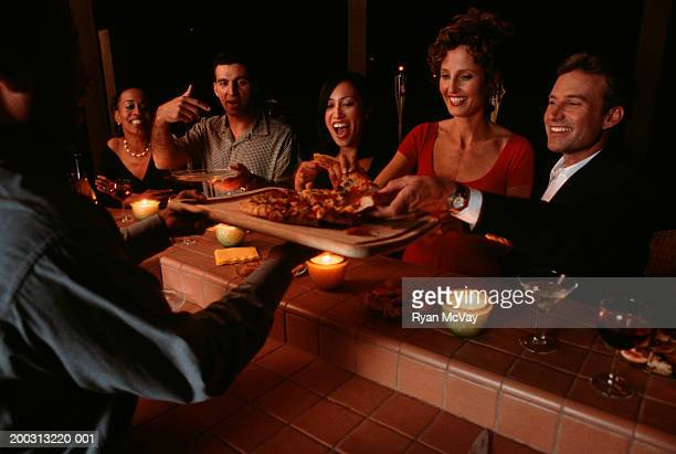 People eating pizza at restaurant
