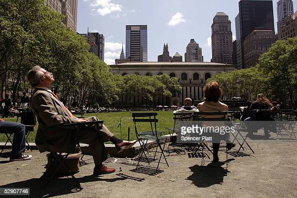 People ejoy a sunny afternoon in the park May 17 2005 in New York City New York once on the brink of bankruptcy with a bourgeoning crime and homeless...