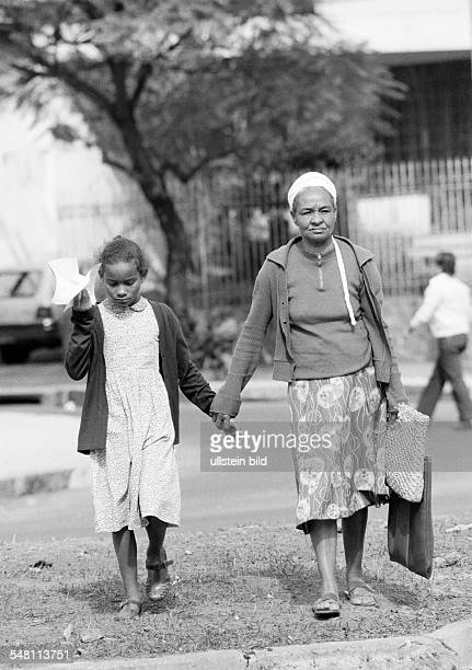 people elder woman and her granddaughter go shopping aged 60 to 70 years aged 10 to 12 years Brazil Minas Gerais Belo Horizonte