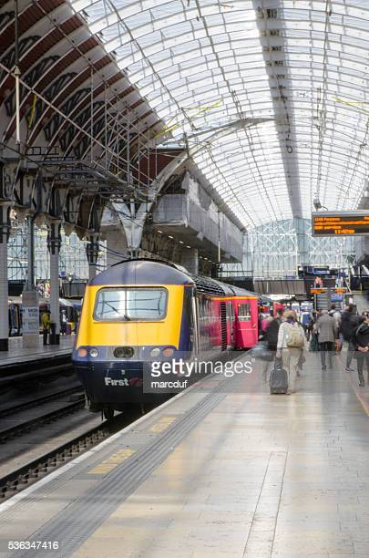 People embarking in train at the Paddington Station