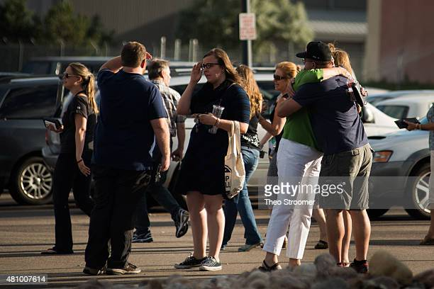 People embrace after a verdict was delivered in the trial of James Holmes at the Arapahoe County Justice Center on July 16 2015 in Centennial...