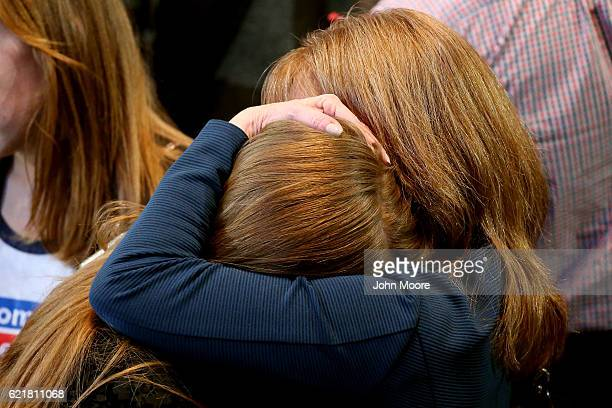 People embraces as they react to the voting results at Democratic presidential nominee former Secretary of State Hillary Clinton's election night...