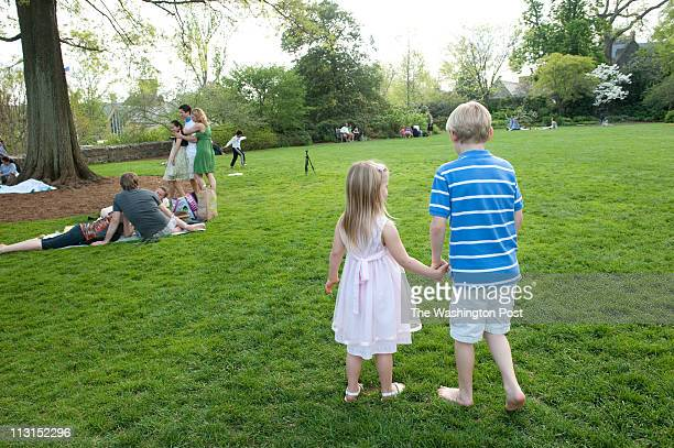 People enjoy a beautiful sunny easter sunday at Bishop's Garden on the grounds of the National Cathedral Makenna Aylward left and Blake Aylward of...