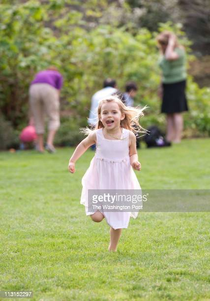People enjoy a beautiful sunny easter sunday at Bishop's Garden on the grounds of the National Cathedral Makenna Aylward of Kensington MD runs...