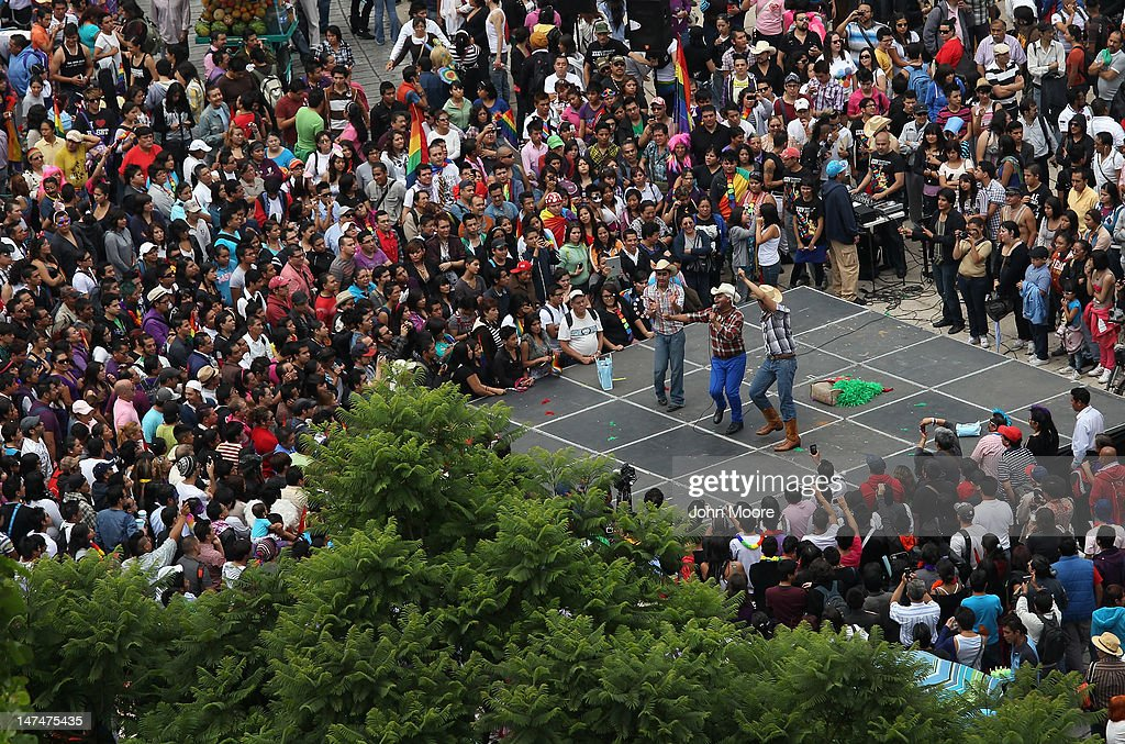 People enjoy a cowboy concert ahead of a gay pride march on June 30, 2012 in Mexico City, Mexico. Mexicans go the polls Sunday for presidential elections.