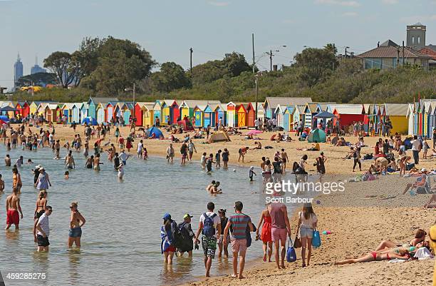 People enjoy a day at the beach on Christmas Day at Brighton Beach on December 25 2013 in Melbourne Australia Brighton Beach features 82 colourful...