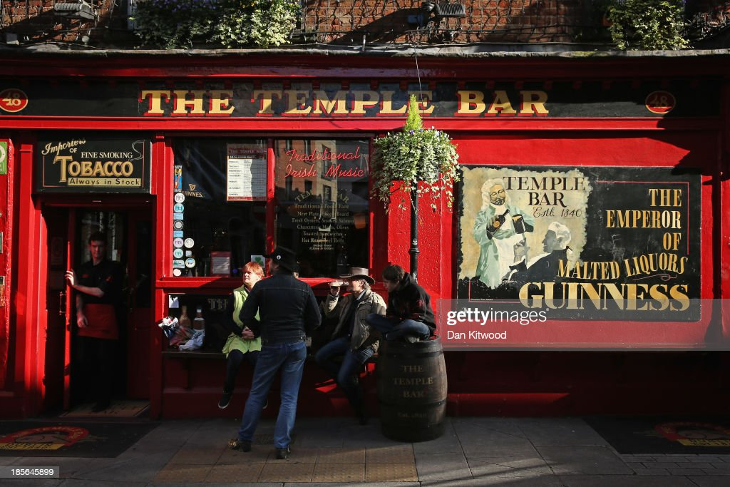 People enjoy a drink outside a bar in the Temple Bar area on October 23, 2013 in Dublin, Ireland. Dublin is the capital city of The Republic of Ireland situated in the province of Leinster at the mouth of the River Liffey. The greater Dublin area has a population of around 1.5 Million people.