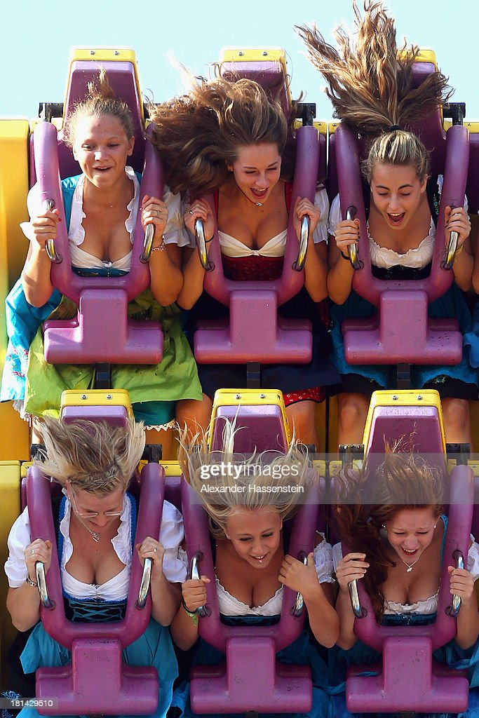 People enjoy a fairground ride during day 1 of the Oktoberfest 2013 beer festival at Theresienwiese on September 21, 2013 in Munich, Germany. The Munich Oktoberfest, which this year will run from September 21 through October 6, is the world's largest beer fest and draws millions of visitors.