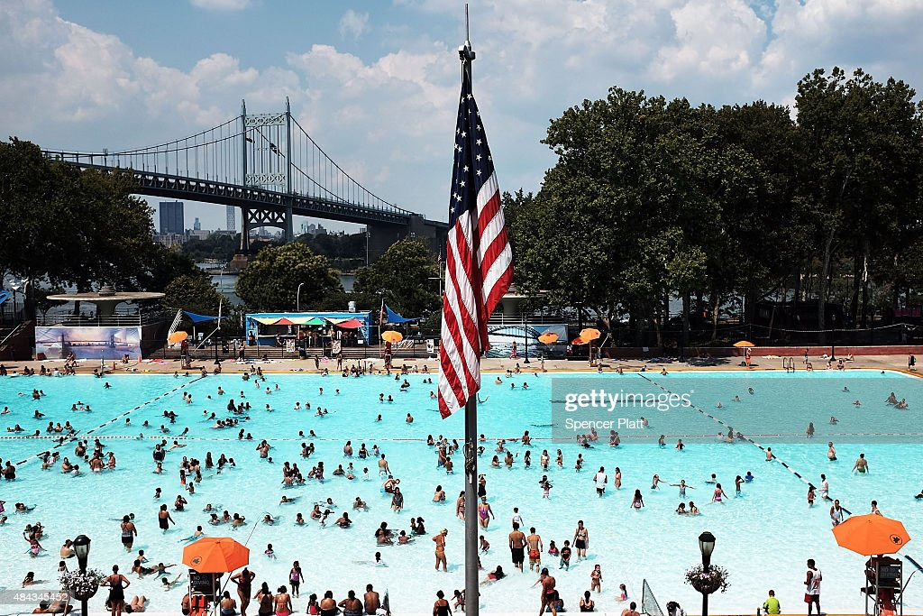 People enjoy a hot afternoon at the Astoria Pool in the borough of Queens on August 17 2015 in New York City The main pool the biggest in New York...