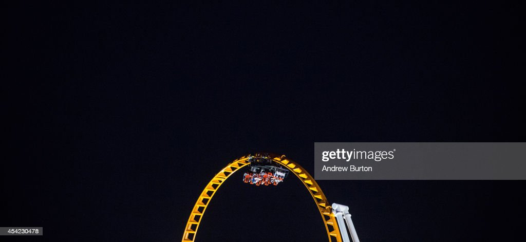 People enjoy a roller coaster at Coney Island on the evening of August 26, 2014 in the Coney Island neighborhood in the Brooklyn Borough of New York City. As August comes to a close, Coney Island's busiest season, summer, is beginning to wrap up.