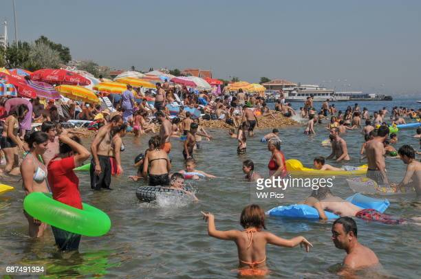 People enjoy a swim on the beach on K›nal›ada K›nal›ada is one of the Prince Islands a small archipelago on the Sea of Marmara It is located a short...